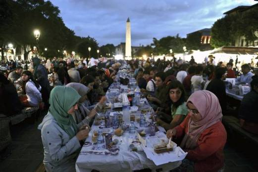 People in Istanbul, Turkey, break their fast at charity tables that offer free meals during the month of Ramadan. In any Muslim country, around the world no person is left to starve during the holy month of Ramadan.  All across the Muslim world, charity tables are setup in order to feed the homeless or anyone who isn't able to make back home in time to break their fast.